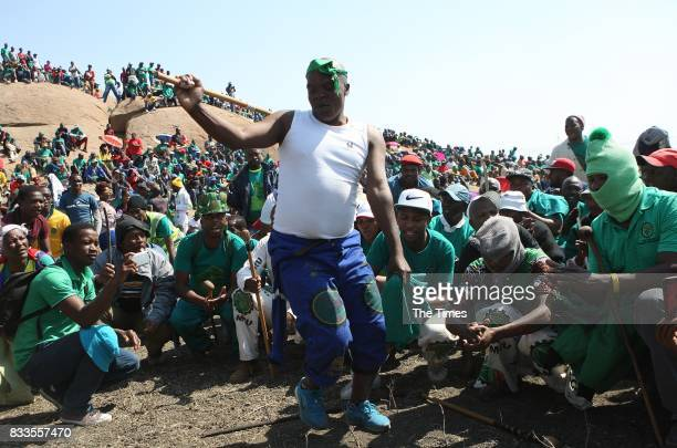 Association of Mineworkers and Construction Union members attend the fifth anniversary commemoration of the Marikana massacre at Wonderkop on August...