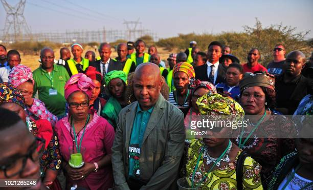 Association of Mineworkers and Construction Union president Joseph Mathunjwa is flanked by widows and family members of the 34 slain miners during an...