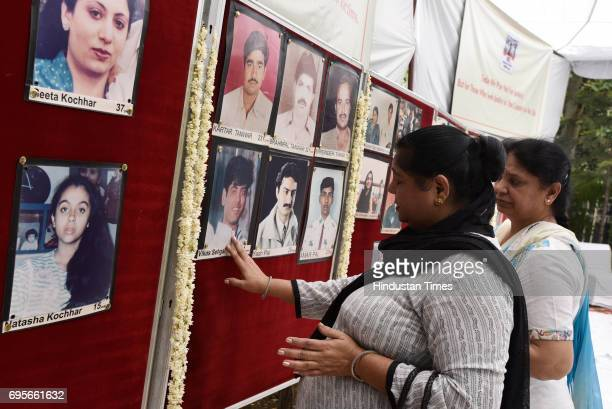 Association of the Victims of Uphaar Tragedy' meet for a memorial outside the Uphaar Theatre, on June 13, 2017 in New Delhi, India. A fire had broken...