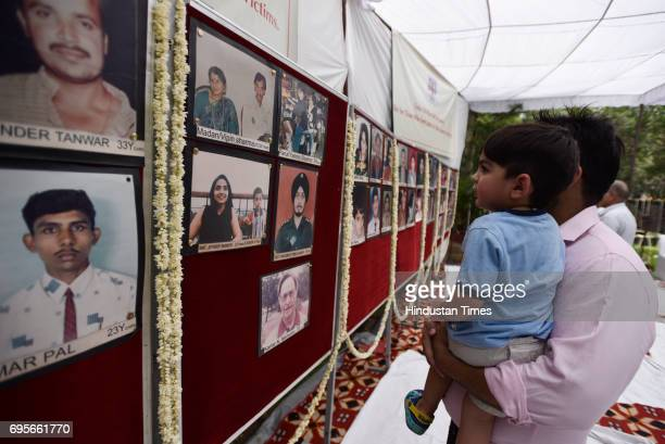 'Association of the Victims of Uphaar Tragedy' meet for a memorial outside the Uphaar Theatre on June 13 2017 in New Delhi India A fire had broken...