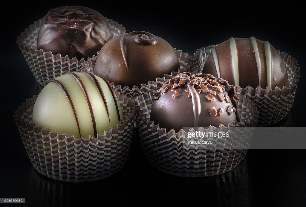 assorted belgian  chocolate praline on a dark background : Stock Photo