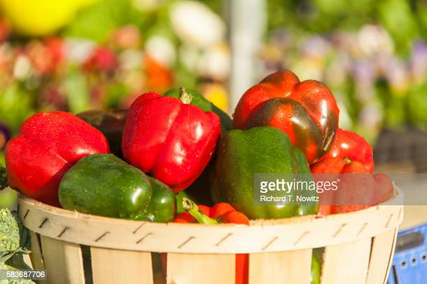 assorted bell peppers in basket - bell pepper stock pictures, royalty-free photos & images