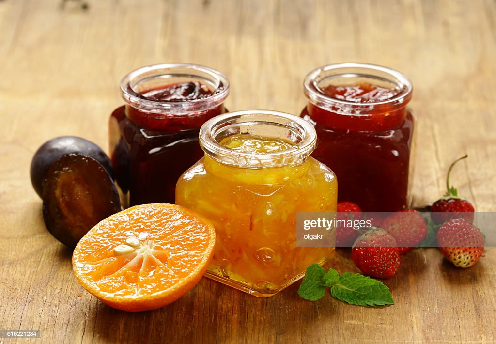Assorted berries and fruit jams. Homemade canning. : Bildbanksbilder