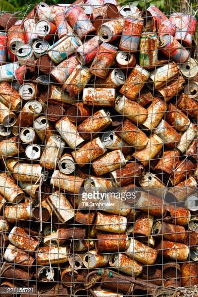 assorted beverages cans trash