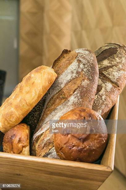 Assorted Bread Loaves in  Wooden Basket