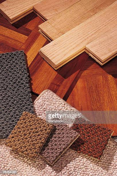 Assorted carpet and wood flooring samples