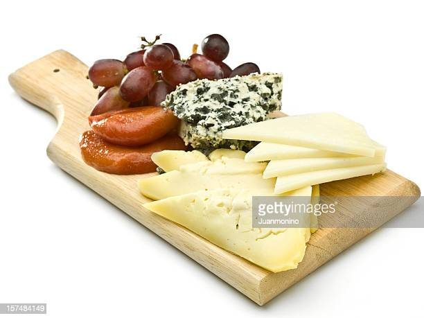 Assorted cheeses and grapes