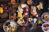 Assorted cheeses fruits nuts platter