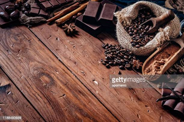assorted chocolate and roasted coffee beans in old fashioned style - coffee with chocolate stock pictures, royalty-free photos & images