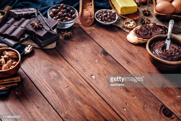assorted chocolate in old fashioned style with copy space frame - chocolate mousse stock pictures, royalty-free photos & images