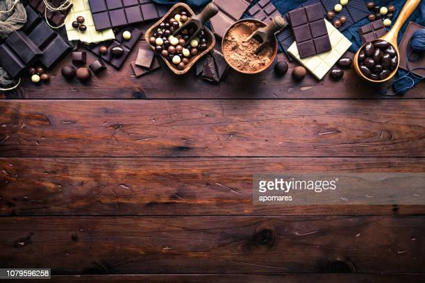 assorted chocolate in old-fashioned style making a frame with copy space - chocolate stock pictures, royalty-free photos & images