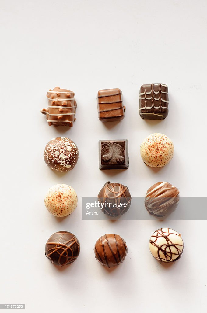 Assorted Chocolates arranged in a gird : Stock Photo