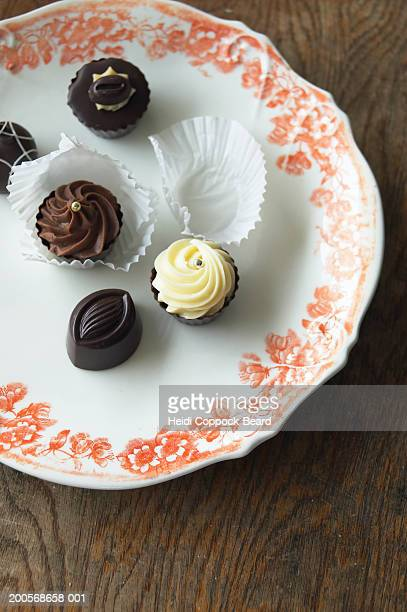Assorted chocolates on plate, overhead view
