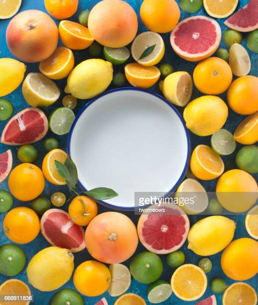 Assorted citrus fruit text space image.