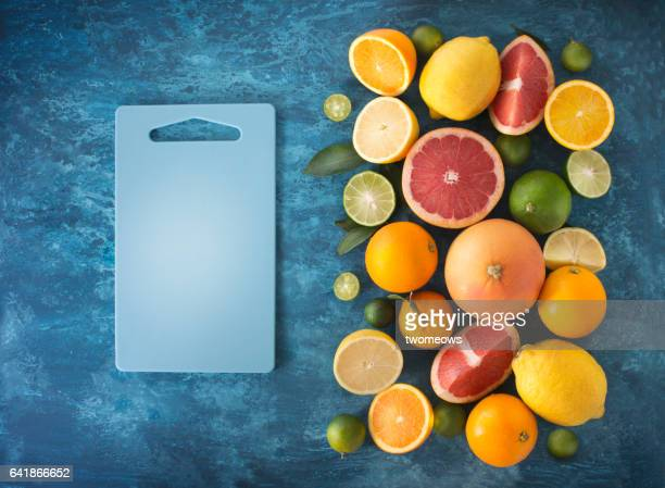Assorted citrus fruits and juice.