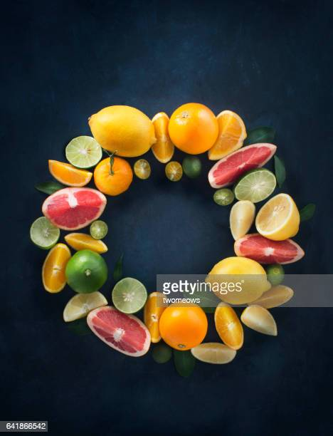 assorted citrus fruits shaped in a circle form. - vitamin c stock pictures, royalty-free photos & images