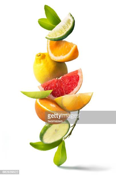 Assorted citrus fruits stack still life.