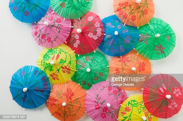 Assorted cocktail umbrellas, overhead view