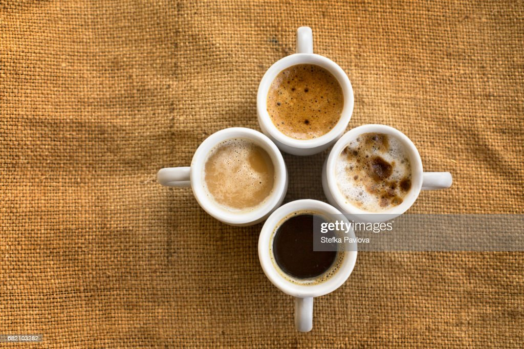 Assorted coffee drinks in cups : Stock Photo