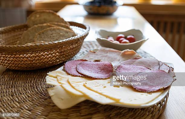 Assorted cold cuts and cheese on a platter