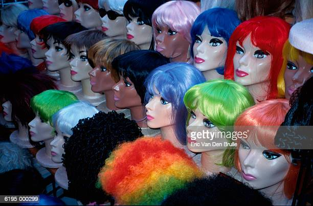 assorted colored wigs - eric van den brulle stock pictures, royalty-free photos & images