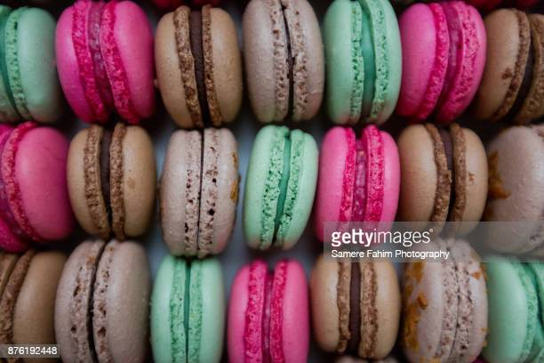 assorted colorful macaroons close up - samere fahim stock photos and pictures
