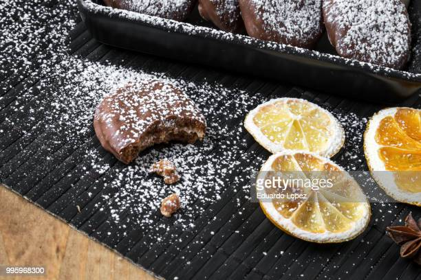 assorted cookies on wooden table - lopez stock pictures, royalty-free photos & images