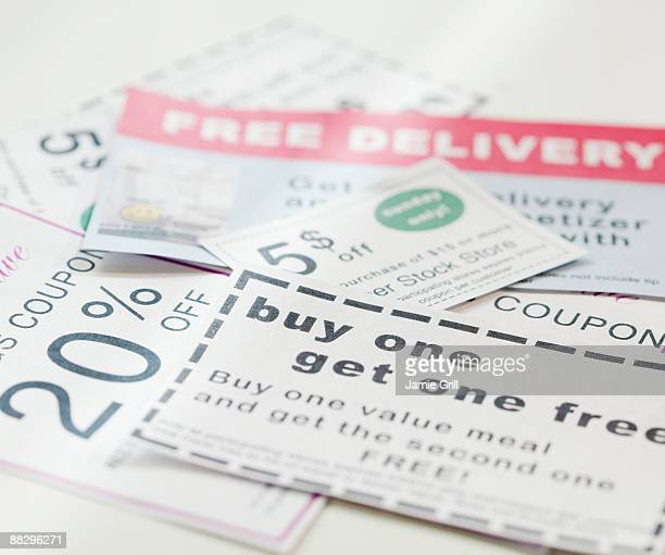 assorted coupons - coupon stock photos and pictures