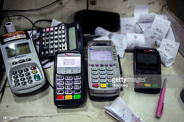 Assorted credit and debit card machines sit at a payment counter at a Hindustan Petroleum Corp gas station in New Delhi India on Monday Nov 11 2013...