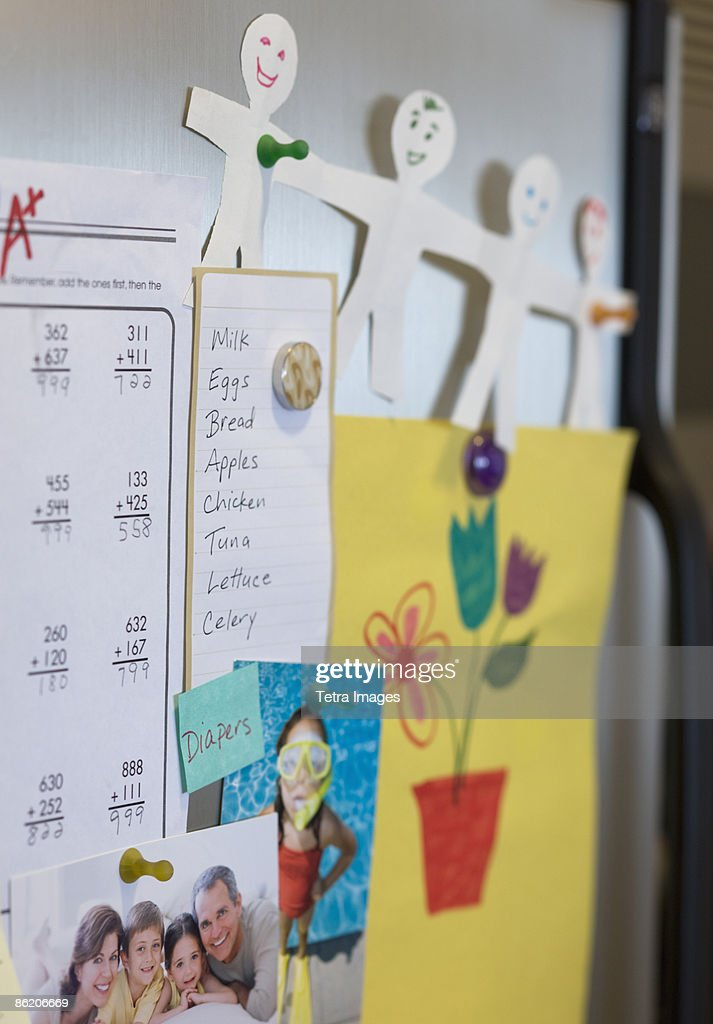 Assorted decorations on refrigerator : Stock Photo