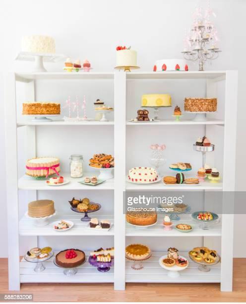 Assorted Desserts on White Shelves