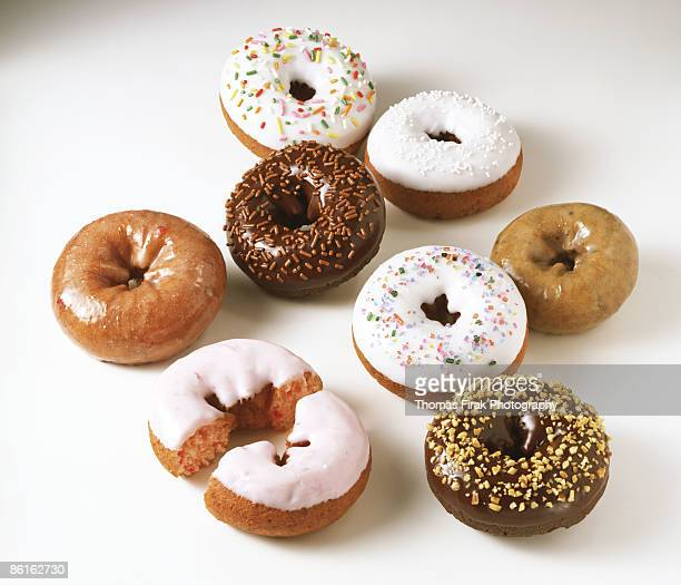 assorted doughnuts on white -  firak stock pictures, royalty-free photos & images