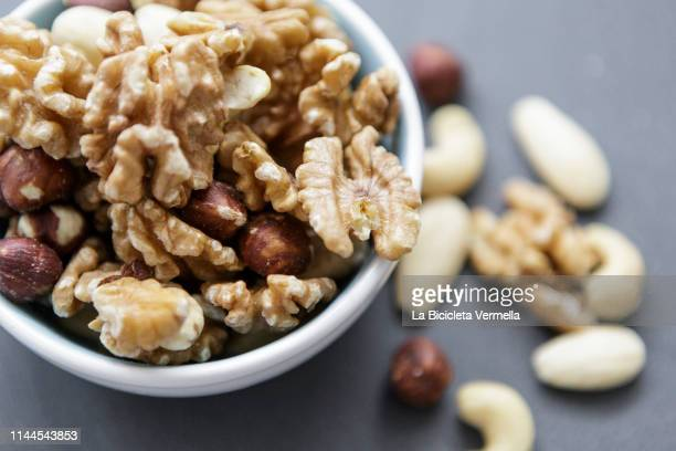 assorted dried fruits - almond stock pictures, royalty-free photos & images
