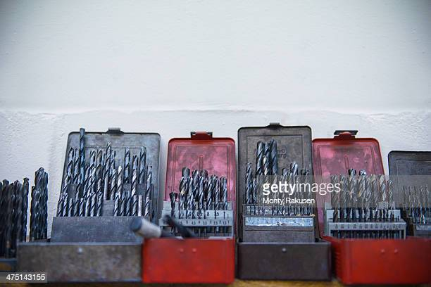 assorted drill bits in engineering factory - drill bit stock photos and pictures