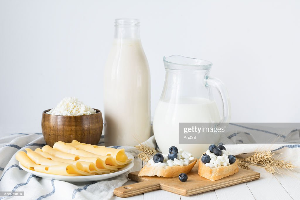 Assorted farmers dairy products on white table : ストックフォト