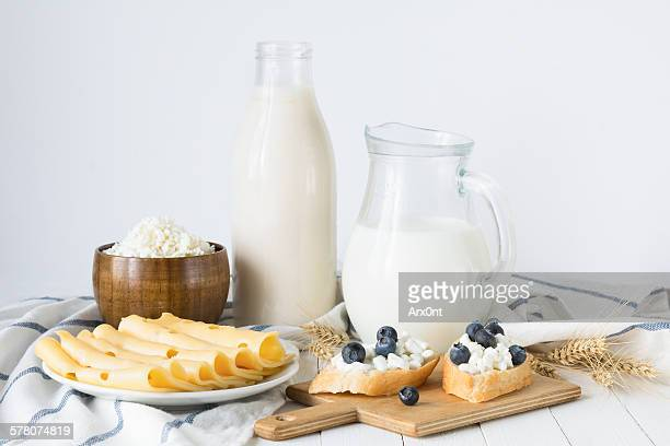 Assorted farmers dairy products on white table