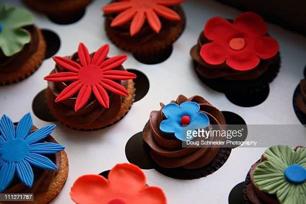 assorted flower cupcakes - marzipan stock pictures, royalty-free photos & images