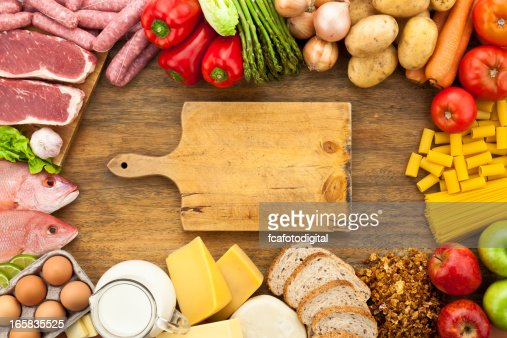 assorted food border on wood table shot from above stock photo getty images. Black Bedroom Furniture Sets. Home Design Ideas