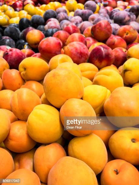 assorted fruits in store display - plum stock pictures, royalty-free photos & images