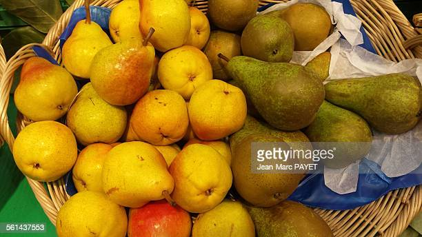 Assorted green and yellow pears in a wicker basket