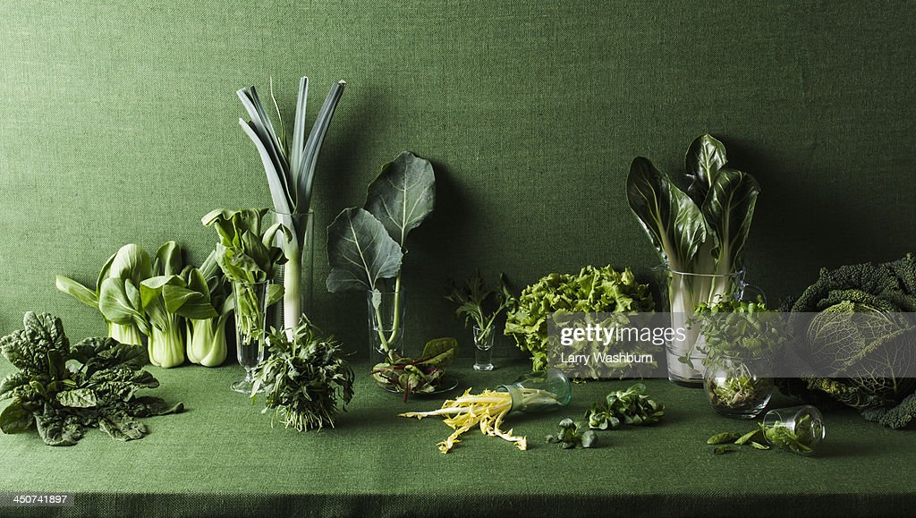 Assorted green vegetables on green table : Stock-Foto