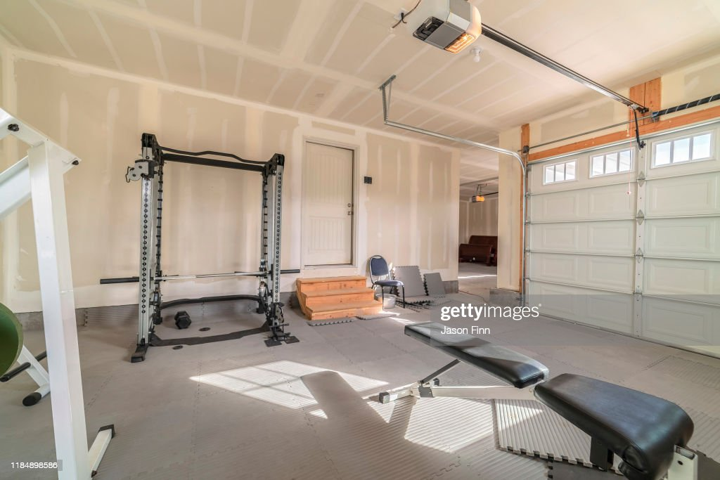 Assorted gym and fitness equipment in a garage : Stock Photo