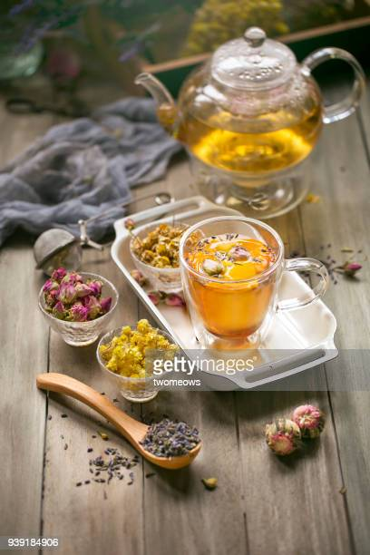 assorted herbal tea ingredients; dried flowers and leaves. - chamomile tea stock photos and pictures