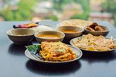 assorted indian food dark wooden background