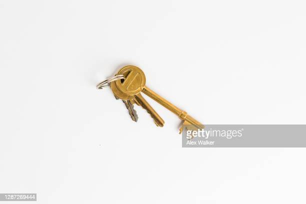 assorted keys on white background - looking down stock pictures, royalty-free photos & images