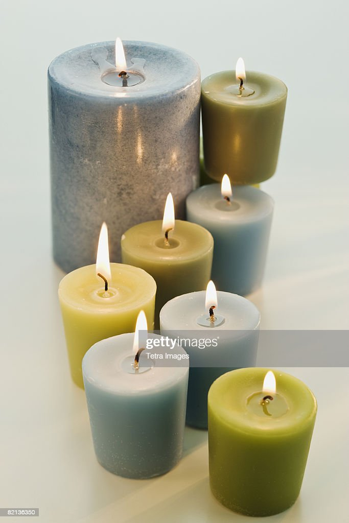 Assorted lit candles : Stock Photo