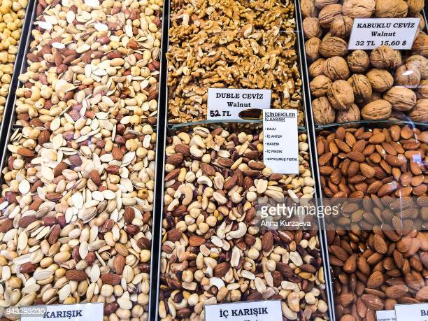 Assorted nuts and mixed nuts selling at street market in Istanbul, Turkey, selective focus. Healthy and tasty snack.