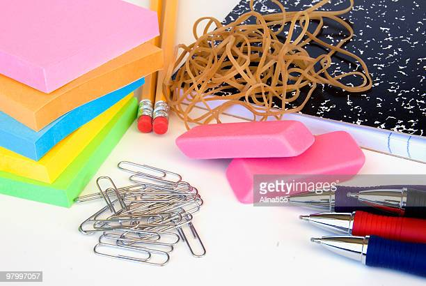 Assorted office supplies on white