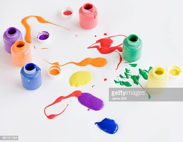 Assorted paints spilled on floor