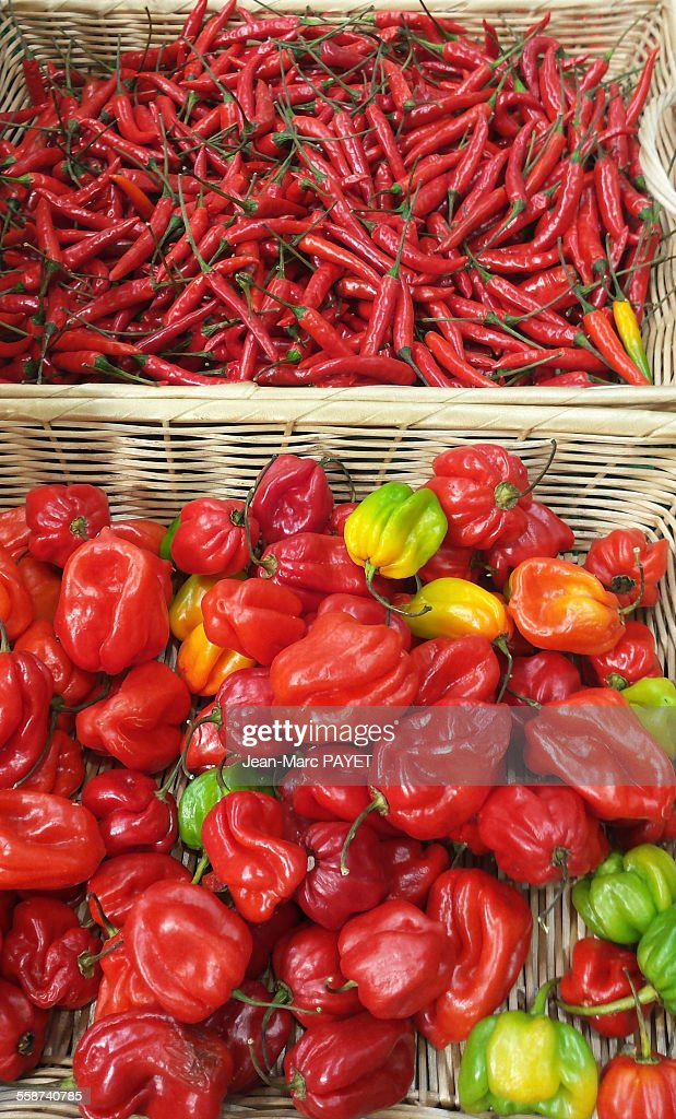 Assorted peppers on a market stall : Photo